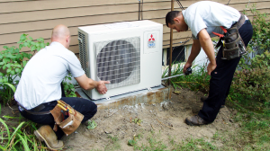 Total Comfort Mechanical's Heating and Air Conditioning specialists at work in Burlington, MA